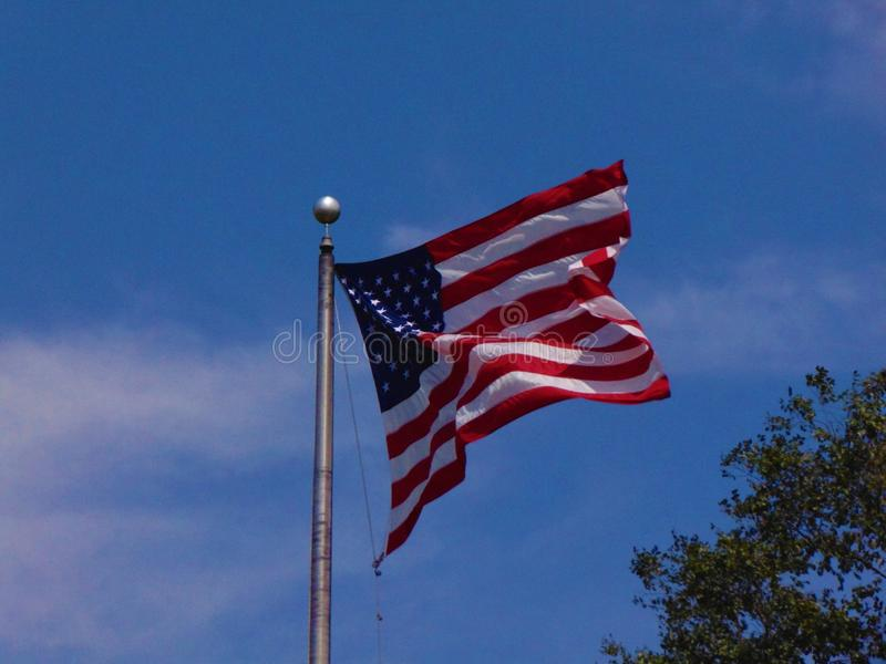 American Flag. Against a bright blue sky with white clouds; Mays Landing, New Jersey stock images