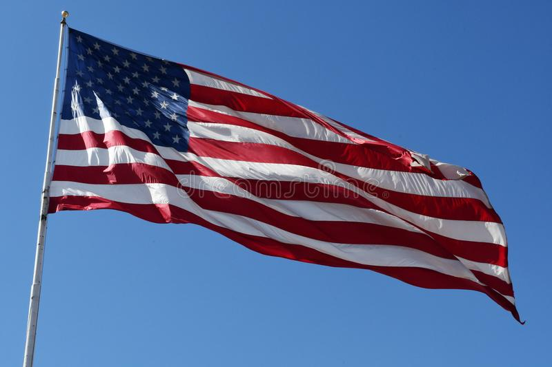 American Flag. An American flag blowing boldly in the wind royalty free stock photos