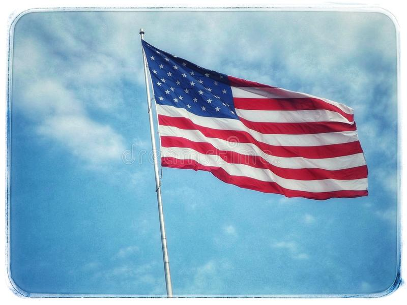 American flag. Flying royalty free stock photography