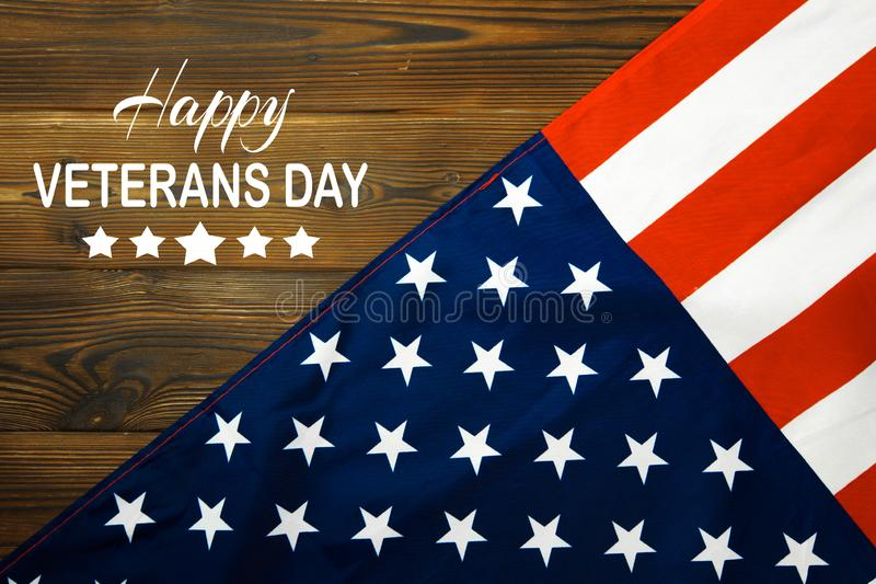 American flag on a antique wooden platform . Veterans Day-  Image stock images