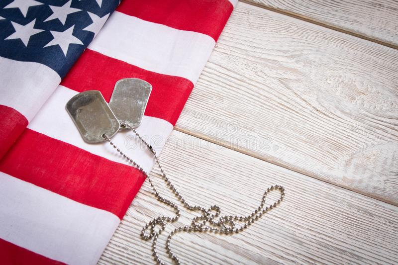 American flag and Army badges on a wooden background. Veterans Day. Memorial day.  royalty free stock images