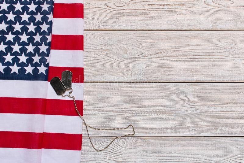 American flag and Army badges on a wooden background. Veterans Day. Memorial day.  stock image