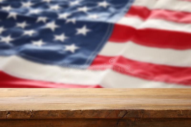 American flag background with empty table for american celebration. Presentation mockup. American flag background with empty table for american celebration stock photos