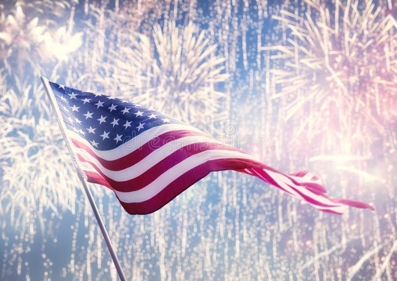 American flag on background of fireworks. Patriotic holiday. The USA are celebrating 4th of July. American flag on background of fireworks stock images