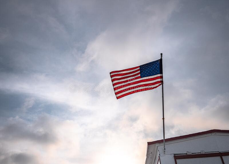 American flag on a background of the sky royalty free stock photography