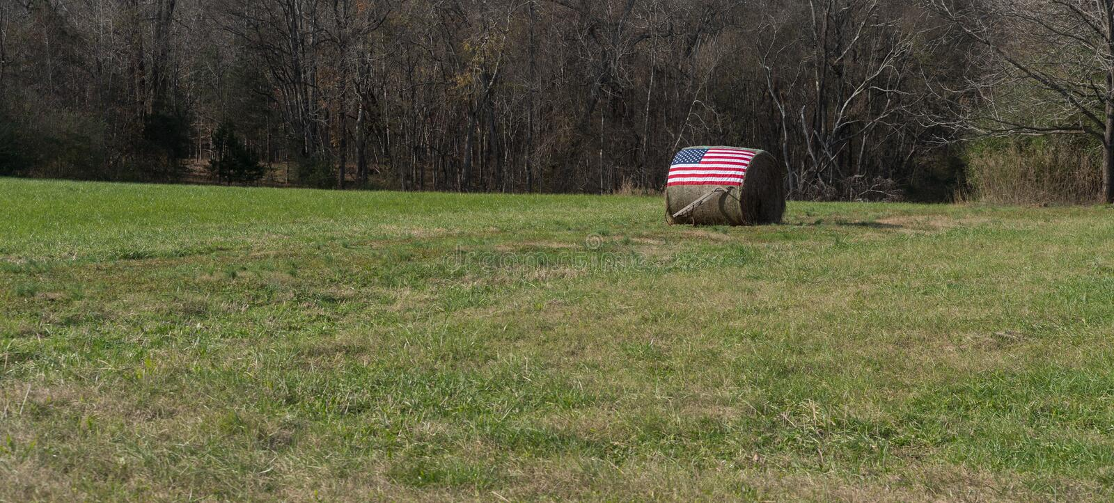 American flag on bale of hay stock photography