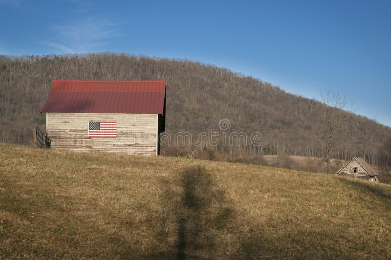 American Flag on Barn in Country royalty free stock image