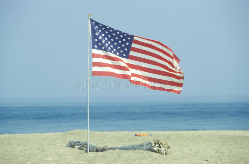 American Flag on the Beach of Lake Erie, Pennsylvania stock photography