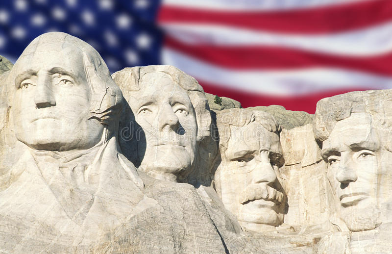American flag behind Mount Rushmore stock images