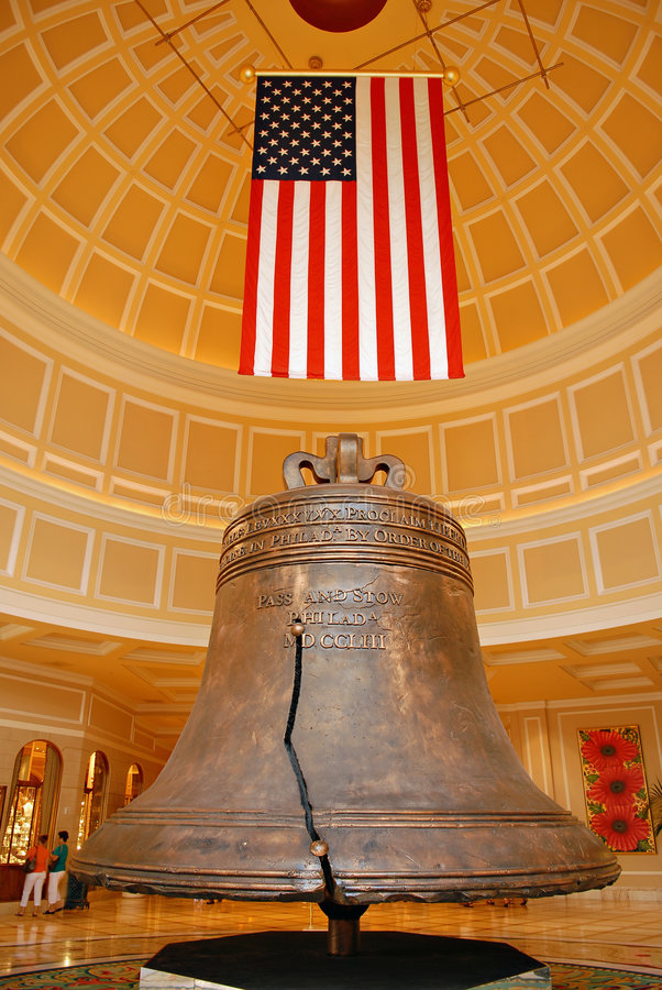 American flag and bell. American bell and flag, proudly displayed royalty free stock photo