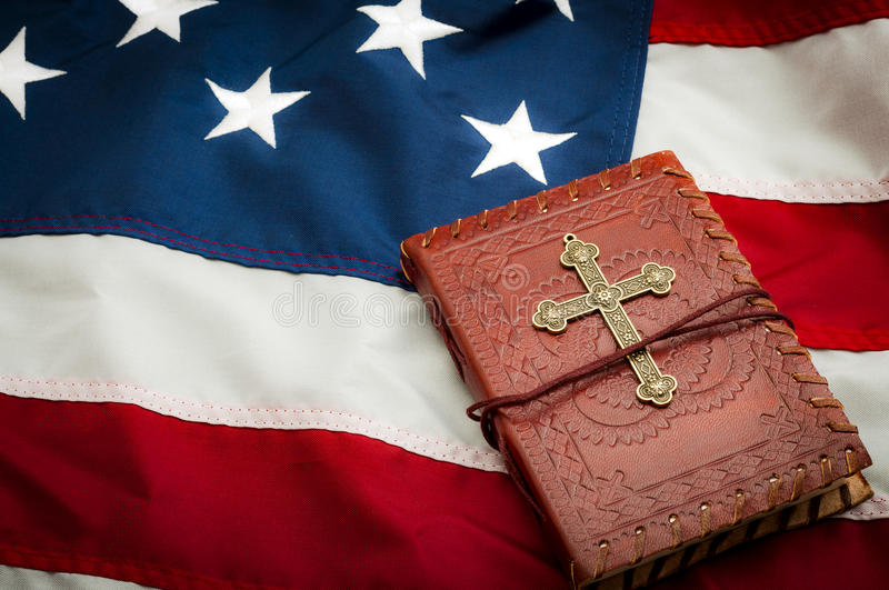American flag and a Bible royalty free stock images
