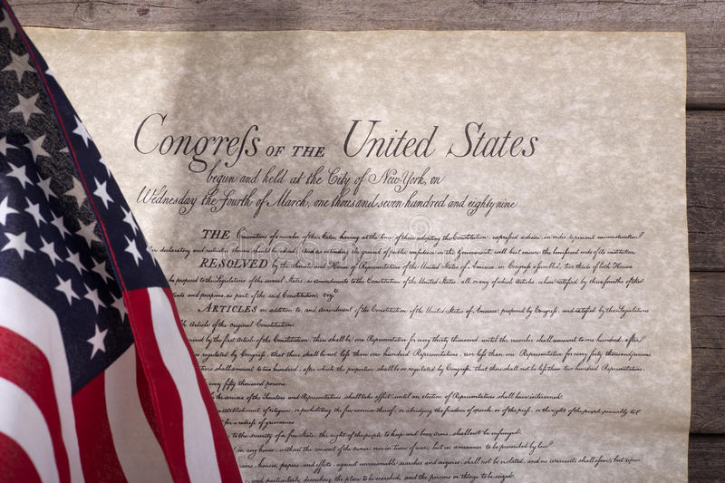 American Flag and the Bill of Rights. American flag and bill of rights on a wood background royalty free stock images