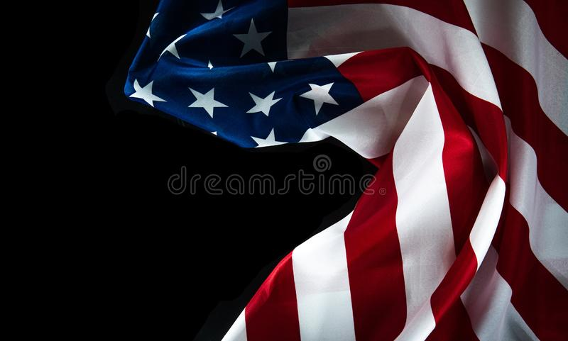 American flag on a black background with space for text royalty free stock photo
