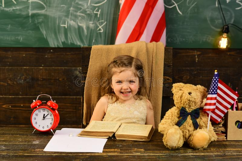 American flag blackboard. Help with homework is widely required among schoolkids now. Concept with US flag and royalty free stock images