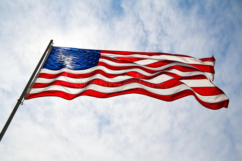 American Flag with Blue Skies. The American flag is a symbol of so many things royalty free stock photos