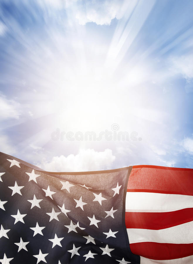 American flag. In blue sky stock photography