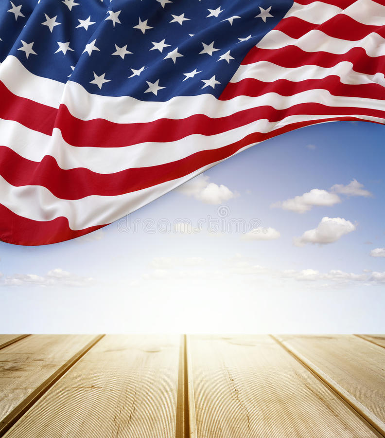 American flag. In blue sky above boardwalk stock images