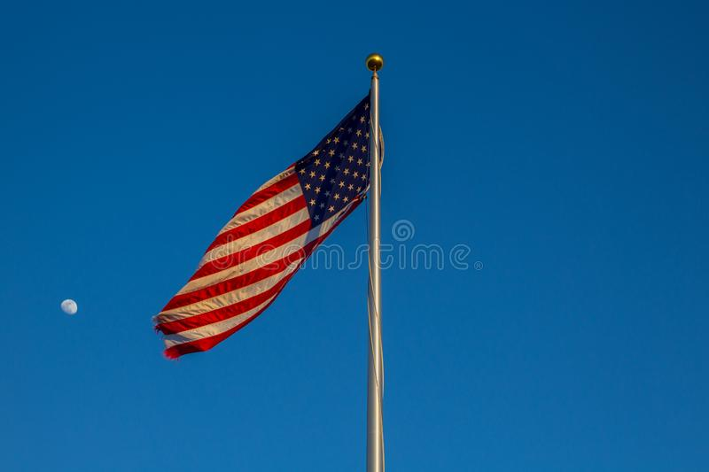 American flag on the blue sky. With a moon in the sky royalty free stock images