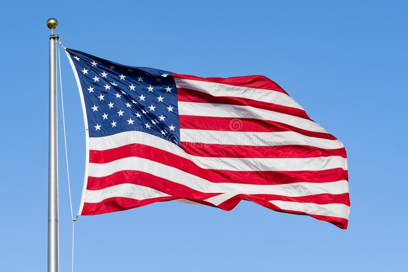 American Flag on a blue sky background; Close Up for Memorial Day or 4th of July stock photos