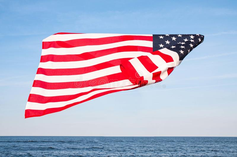 American flag on blue sky. USA Independence day, 4th July. United States flag royalty free stock photography