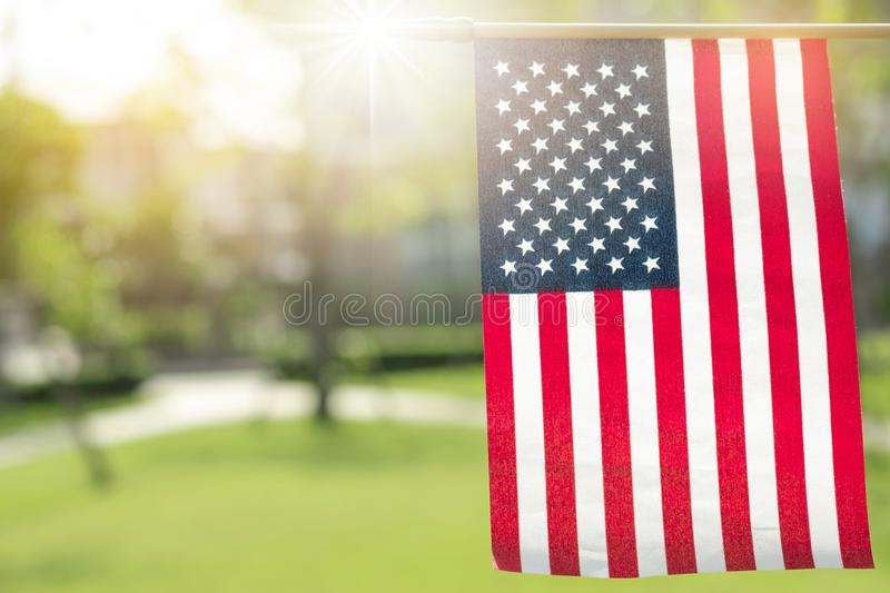 American flag with bokeh natural background and sunlight for Memorial Day or 4th of July. royalty free stock photos
