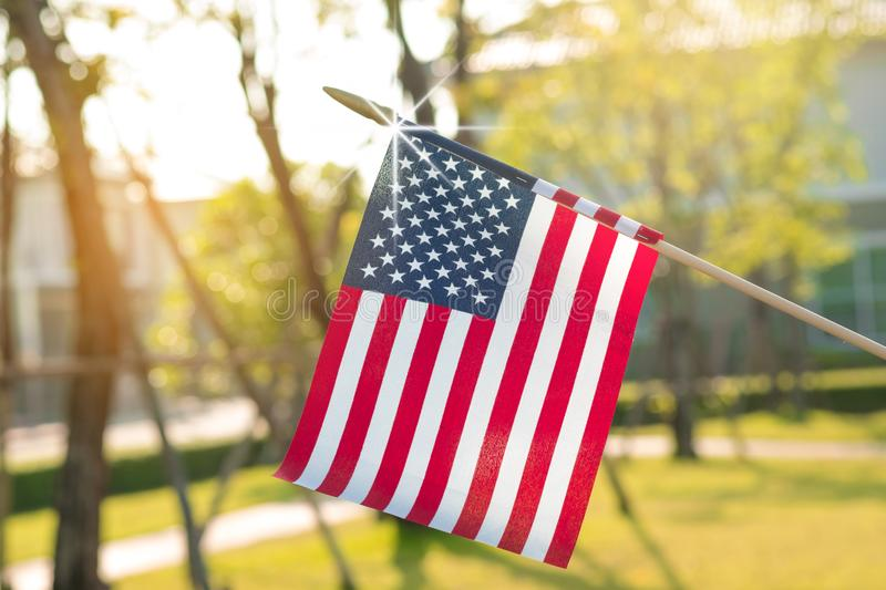 American flag with bokeh natural background and sunlight for Memorial Day or 4th of July. stock photography