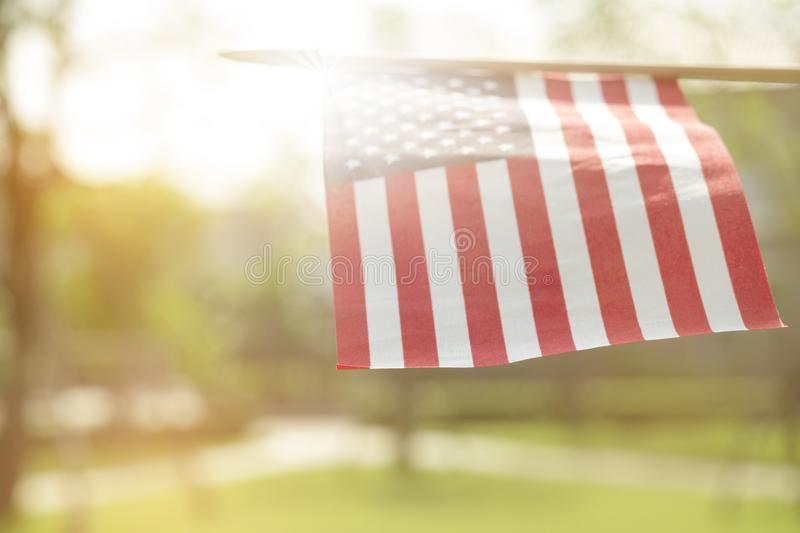 American flag with bokeh natural background and sunlight for Memorial Day or 4th of July. stock photos