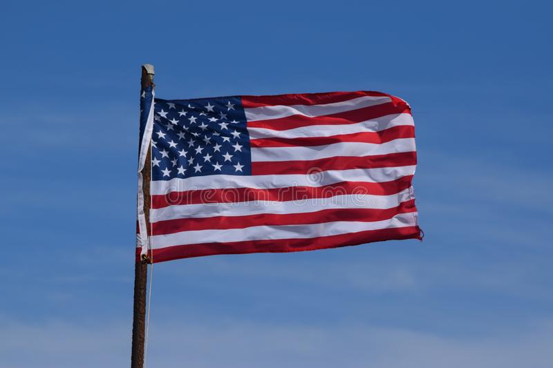 American flag in a bright blue sky royalty free stock photo