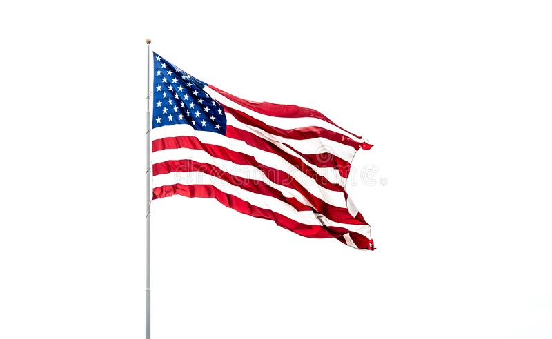 American Flag With Bright Red White And Blue Colors On White Background. stock photo