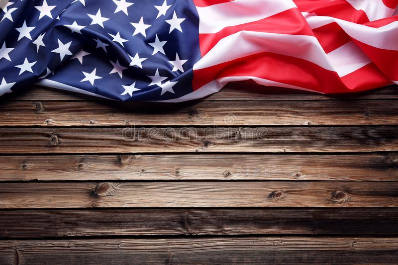 American flag. On brown wooden table stock photos