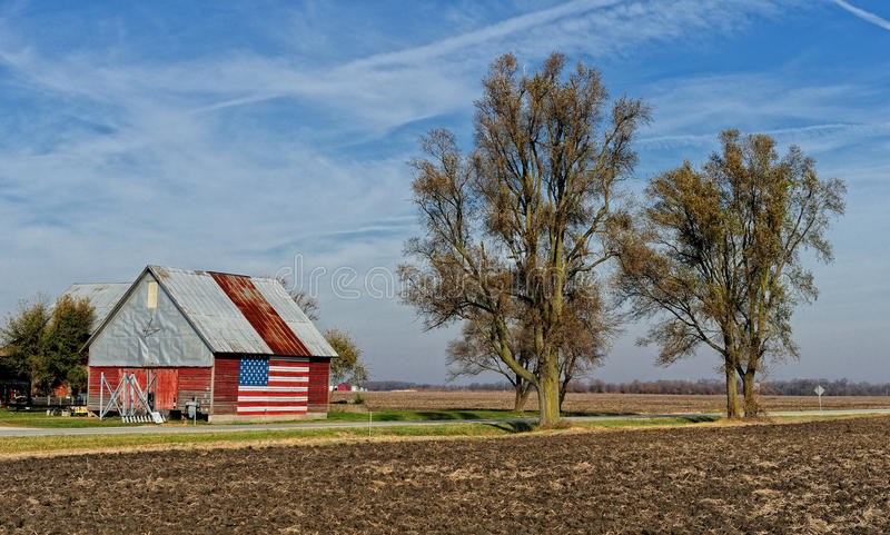 American flag on building. American flag painted on building located on rural road in Illinois stock images