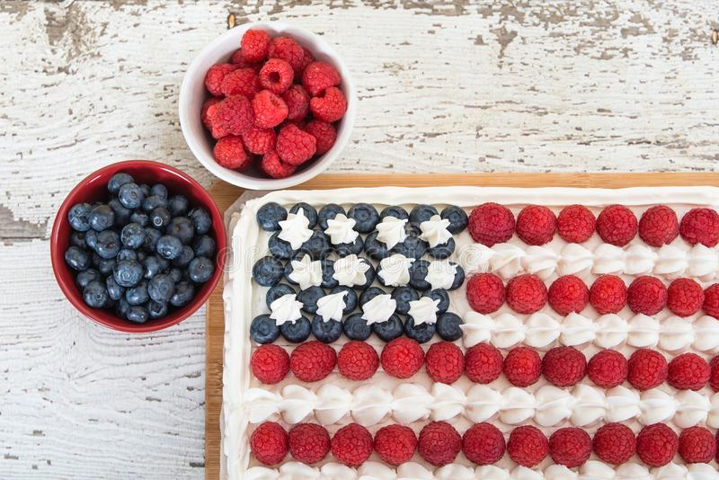 American flag cake with blueberries and raspberries royalty free stock images