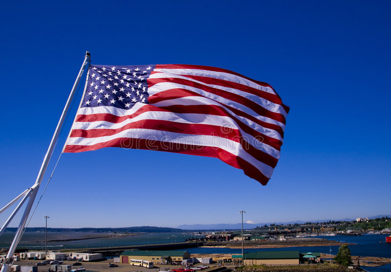 American Flag on a Carrier. The American Flag on the stern of the aircraft carrier USS Abraham Lincoln docked at the Port of Everett, WA stock image