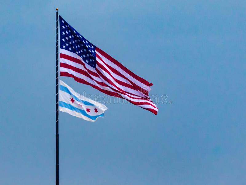 American flag and Chicago flag  on blue sky background. Patriotism, Pride, Honor royalty free stock photos