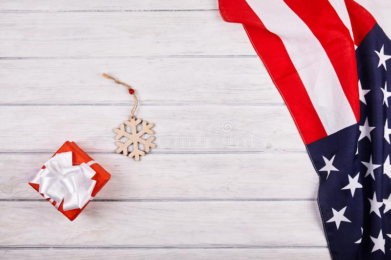 American flag with christmas decorations. On wood desk. Place for text royalty free stock images