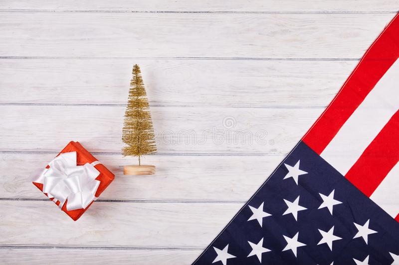 American flag with christmas decorations. On wood desk. Place for text royalty free stock photo