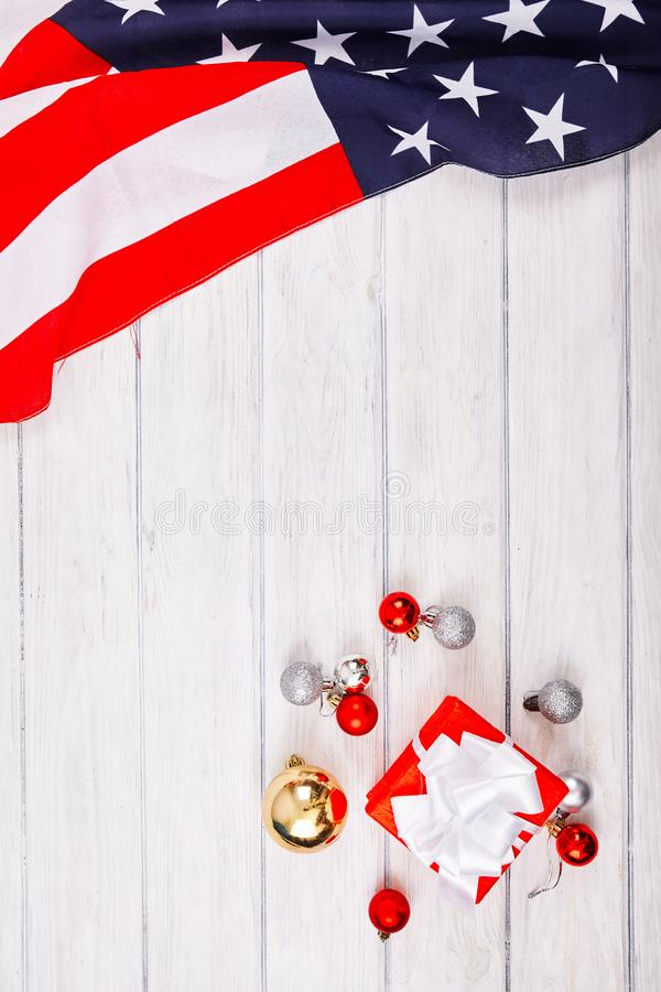 American flag with christmas decorations. On wood desk. Place for text royalty free stock photos