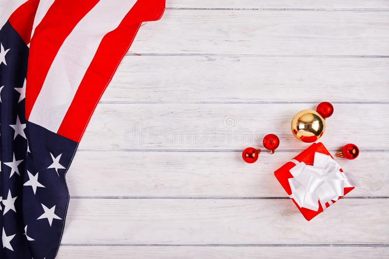 American flag with christmas decorations. On wood desk. Place for text stock images