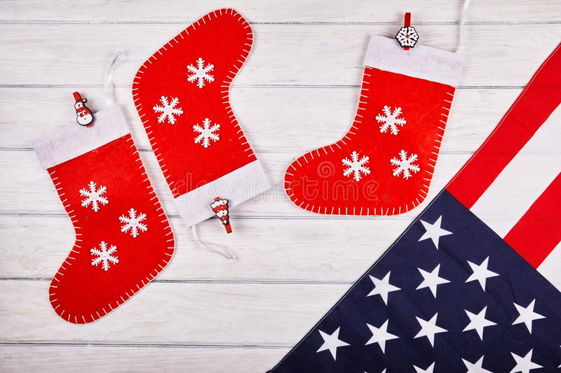 American flag with christmas decorations. On wood desk. Place for text stock image