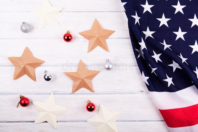 American flag with christmas decorations. On wood desk. Place for text stock photos