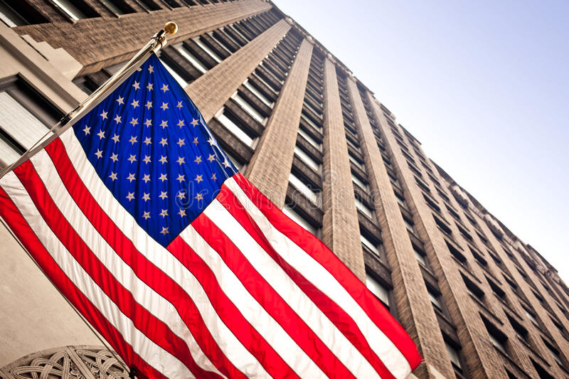 American flag in city. American flag on city background stock photo