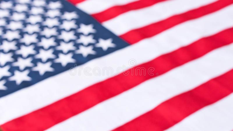 American flag. Close up. American flag blurred background. Concept of patriotism.  royalty free stock image