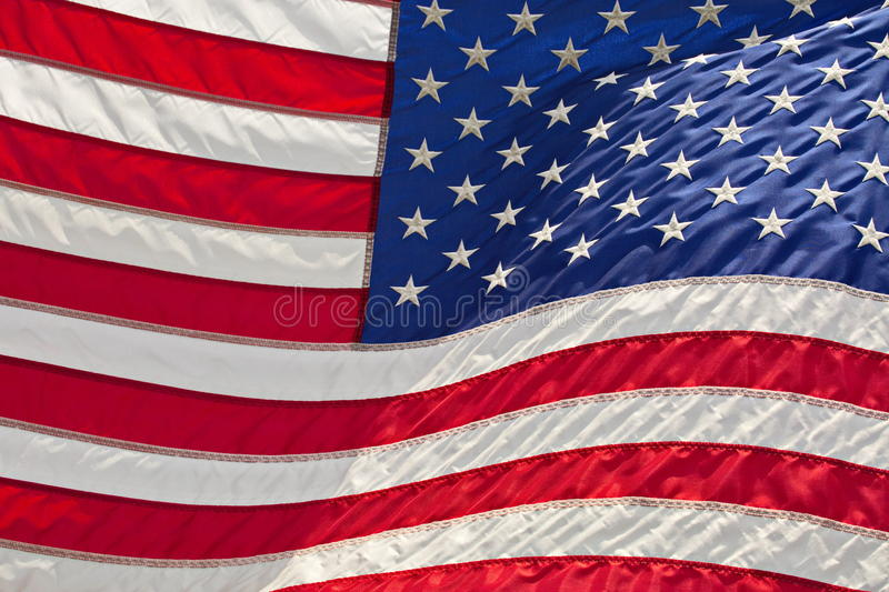 American Flag. Close-up of the American Flag flying in the breeze royalty free stock photos