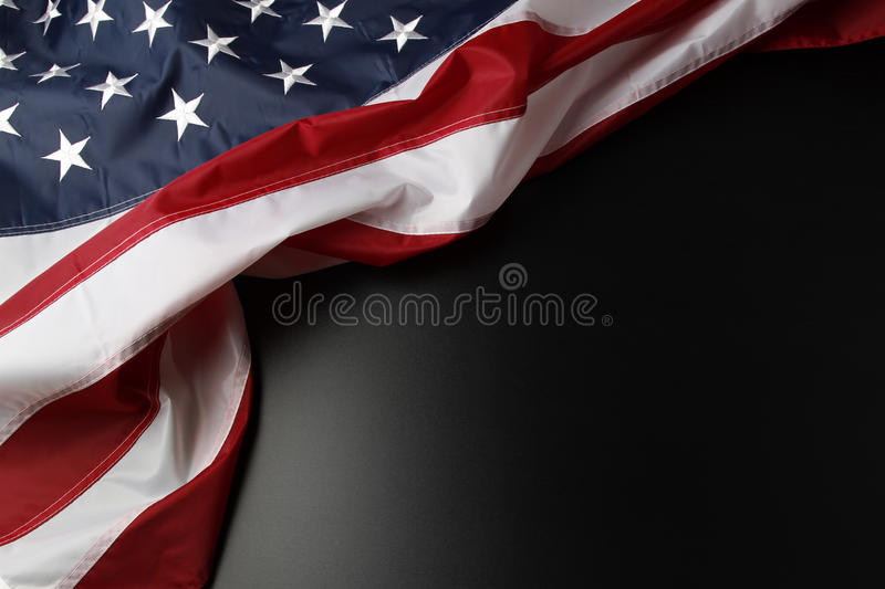 American flag. Closeup of American flag on dark background stock photos