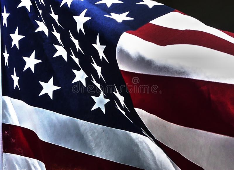 American Flag Closeup fills the frame with red white and blue stars and stripes stock image