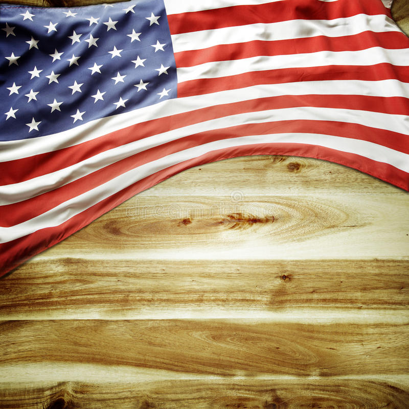 American flag. Closeup of American flag on wooden background stock photo