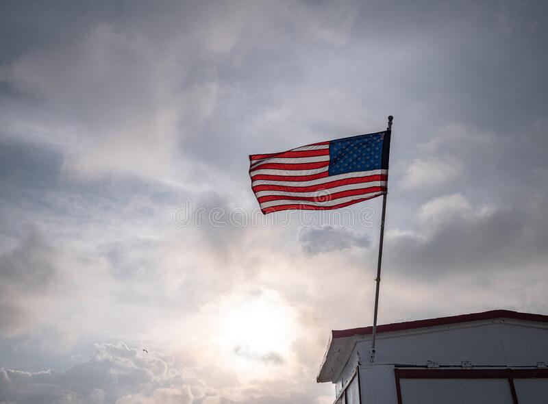 American flag in cloudy weather stock photo