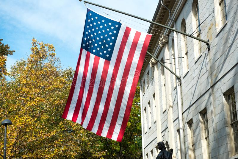 American flag on the college campus building.  royalty free stock photo