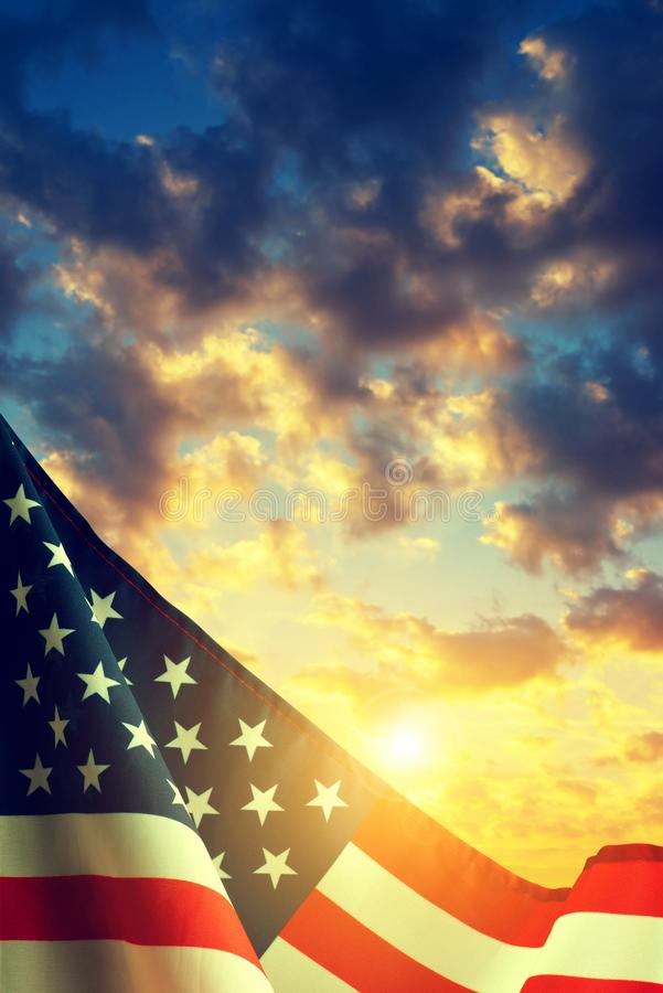 American flag at sunset. American flag with colorful sunset sky at the background royalty free stock photos
