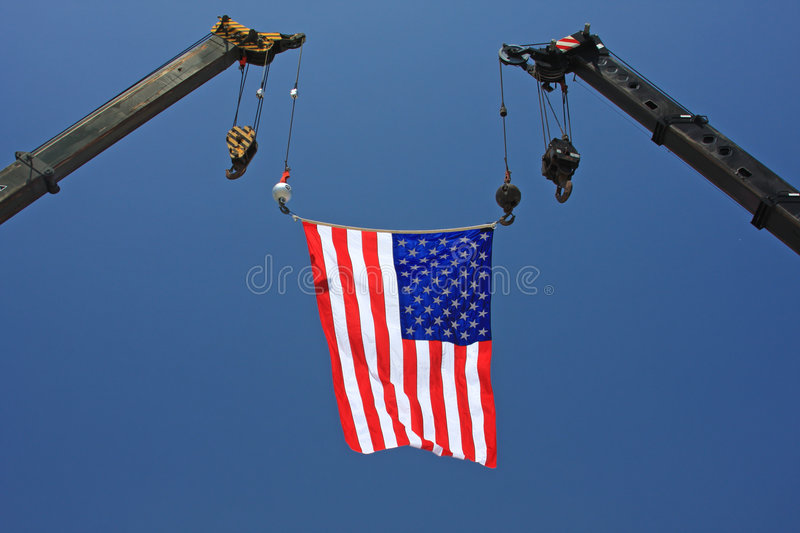American Flag on Crane royalty free stock photography